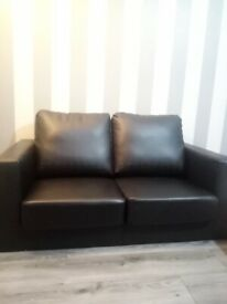 Black Faux leather two seater sofa, brand new!