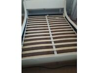 Low cream leather kingsize bed