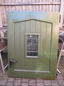 Lovely exterior lockable stable door with furnishings and a small glass window
