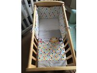 Beautiful wooden deluxe gliding crib. Mattress and bedding included. Still selling in mothercare.