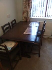Dark wood dining table and 6 chairs (2 Carvers) Olive green seats