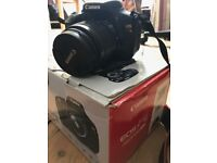 Canon Kiss X5 DSLR Camera with lens and accessories