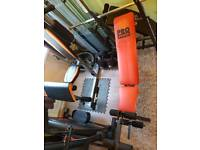 Folding workout bench with barbell