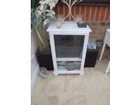 White cabinet complete with sound system and speakers