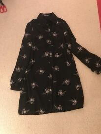 Black size 6 shirt with flowers
