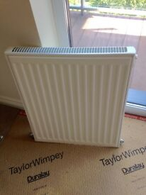 White radiators for hot water central heating system