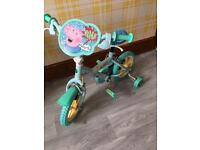 George Pig bike with stabilisers