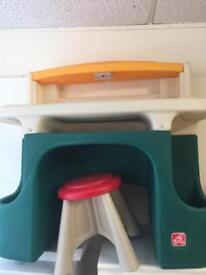 Child's desk with stool with light on table