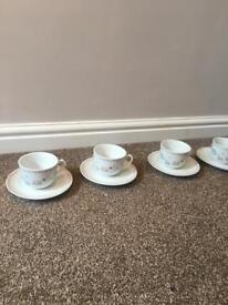 4 x teacups and saucers (teacup/flower/butterflies motif)