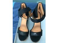 Black strap wedges. Size 4 Never Worn.