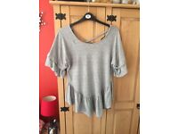Brand New Ladies Top. Colour light grey. Size 12 beautiful top.