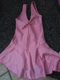Girls pink dance leotard, ballet and tap shoes.