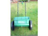 Virtually New Scott's Drop Spreader with Grass Seed and Other Grass Food.