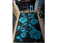 Black rug with blue flowers