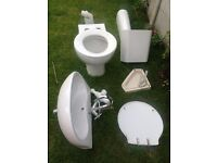 Corner bathroom toilet, sink and taps all in good clean condition
