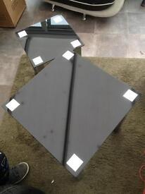 Two black glass tables & chrome legs