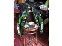 Large green and black leather racing motorcycle jacket
