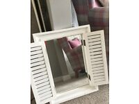 Shabby chic mirror with louvre doors.