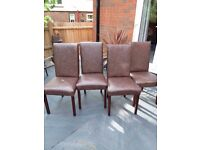 FOUR BROWN FAUX LEATHER DINING CHAIRS
