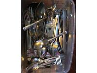 Lots of cutlery and utensils
