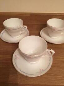 Three English bone china cups and saucers