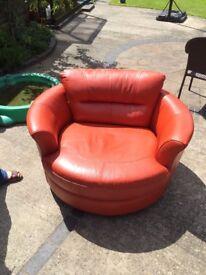 orange leather cuddle chair