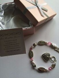 'Daughter' bracelet. Pink gem, heart, silver. In box with card.