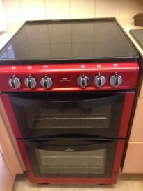 New World electric free standing double oven and hob.