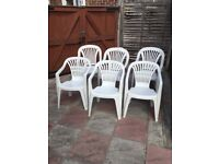 SIX (6) White Plastic Garden Chairs- IDEAL FOR THE GARDEN IN SUMMERTIME or INDOOR USE.