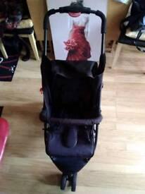 Black stroller for baby.