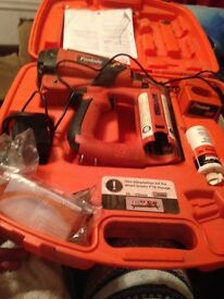 Paslode IM65 F16 nail gun for sale in case with everything as seen in pic