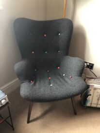 Curved grey armchair