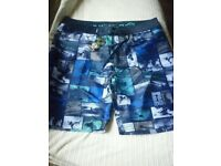 mens urban beach board shorts,new with tags on,size xxl.
