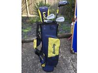 Dunlop, set of children's golf clubs. Including a wood, two irons and a putter, in a Dunlop golf bag