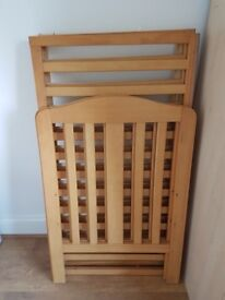 Cot bed from Mohercare - sturdy and excellent condition. Dismantled, can easily fit into a car boot