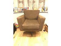 Designer fabric chocolate swivel armchair