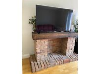 Fireplace for feee if you can remove it for me bricks storage mantle