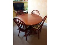 Round Rosewood/mahogany Ding table and four Chairs