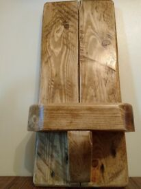 Rustic reclaimed pallet wood wall sconce.