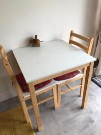 Dinning table and two chairs