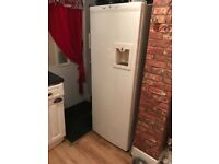 Tall fridge like an American one with drinks despenser
