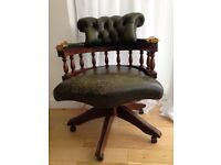 Reclining Captain's Chair in green leather