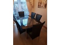 Black and chrome glass table with 6 chairs