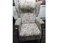 Armchair with detachable headrest .
