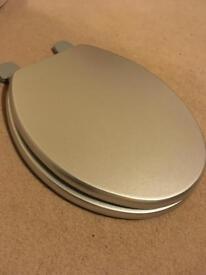 Silver toilet seat - New