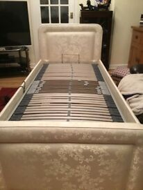 Single bed with mattress raise function and massage