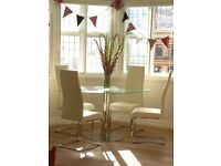 Oval glass dining table and four faux leather (white/cream) chairs