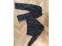 Black Umbro water proofs xlarge boys trousers and small men's jacket