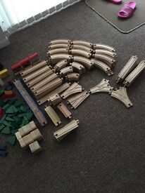 Wooden train track and trains