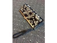 Black handbag with flower detail